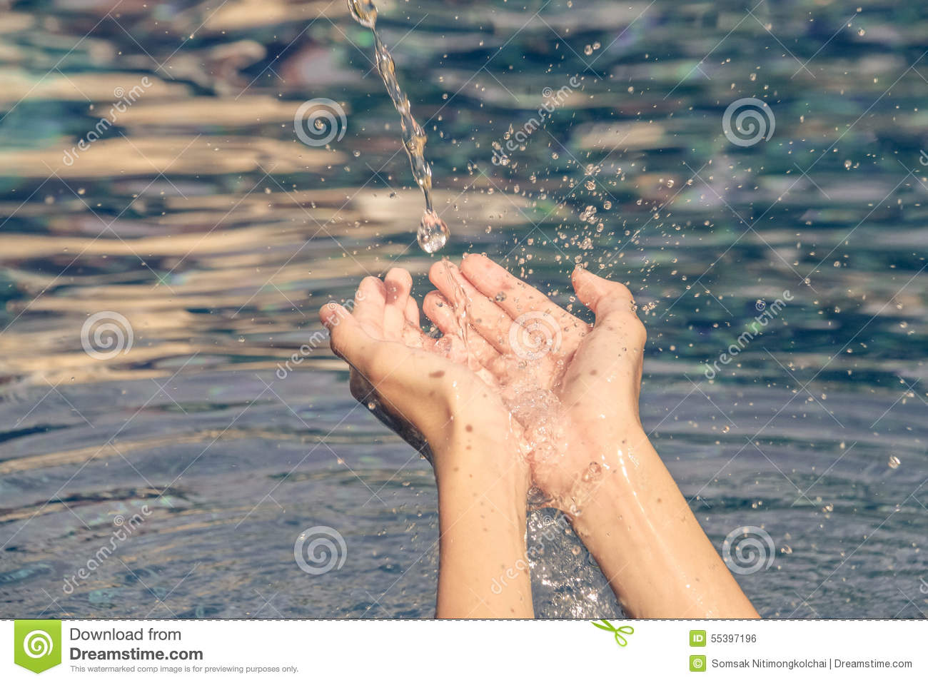 Hope concept : human hand with the water fall down to the palm