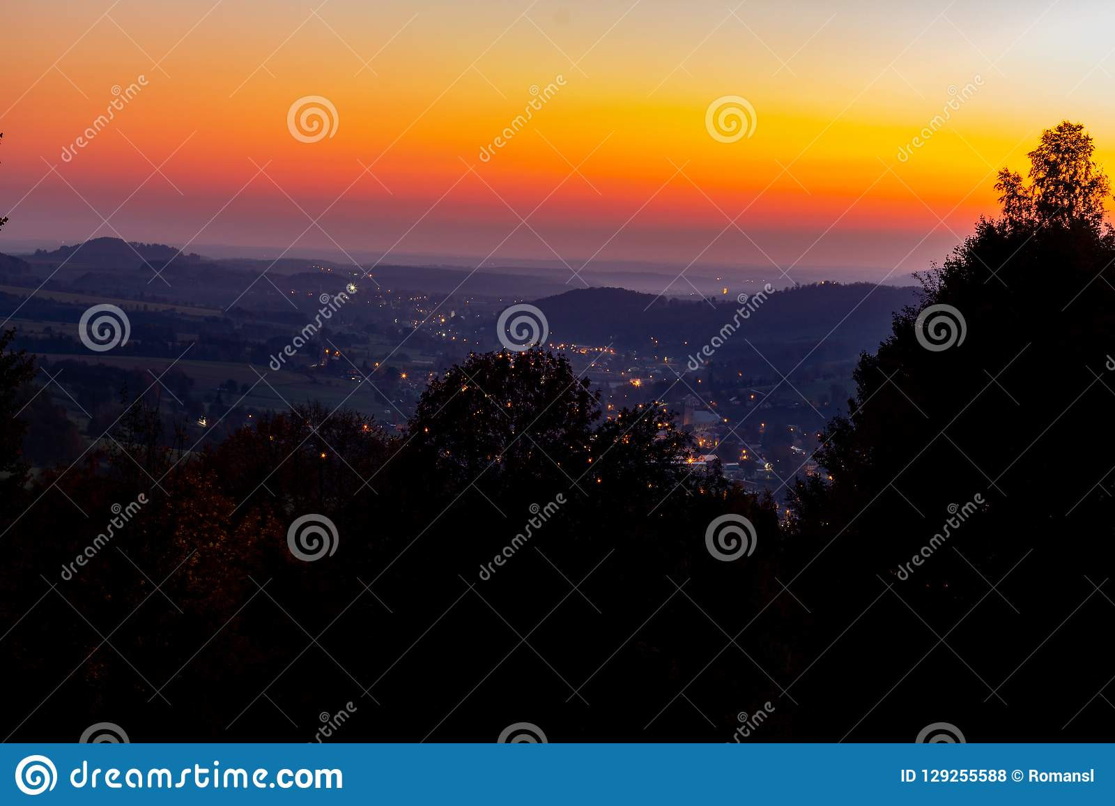 Horizon line of orange sky and clouds with beautiful golden orange sunset time with light sunrise nature
