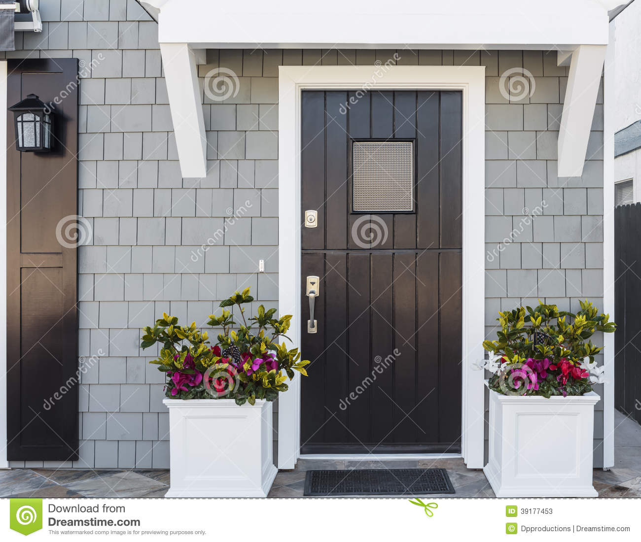 Horizontal of black front door to family home stock photo for Black wooden front door