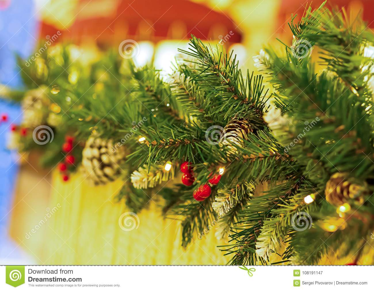 Horizontal border branch of fluffy green fir with cone and red holly berries with perspective street decoration celebrating