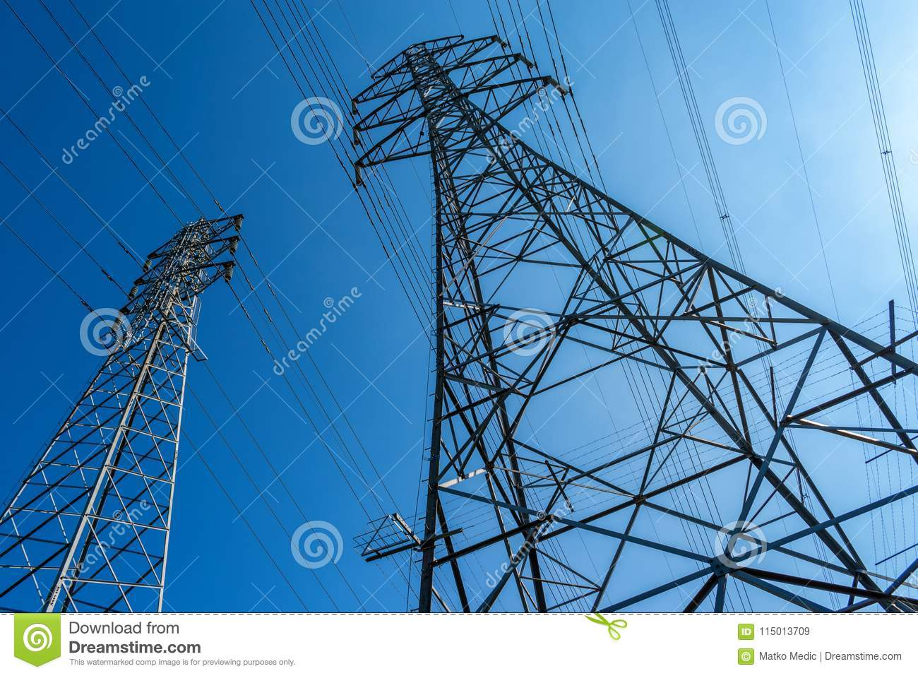 High voltage electrical power lines and blue sky