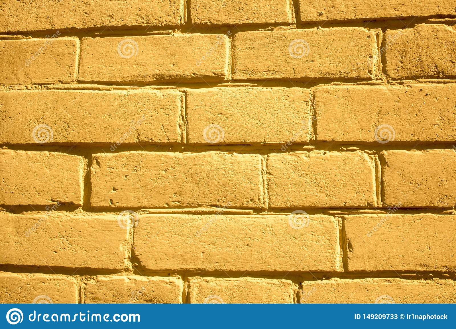 Yellow brick wall background for designers