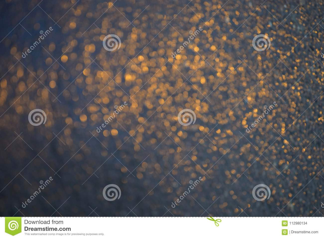 Blurred orange reflections on a blue background