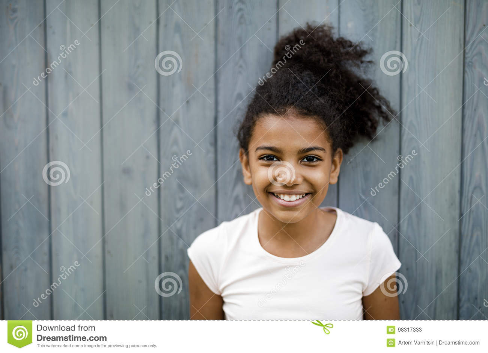 Horizontal shot of happy cute girl