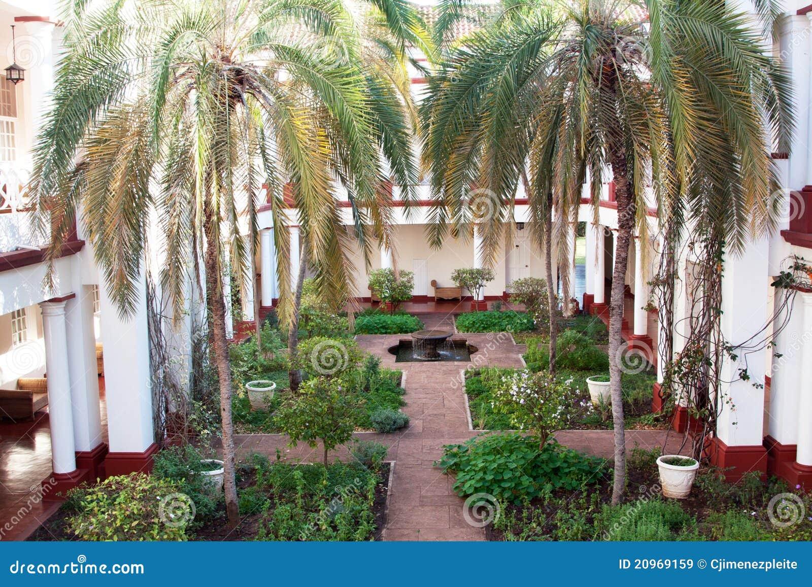 Horizontal victorian hotel garden royalty free stock for Garden design zimbabwe