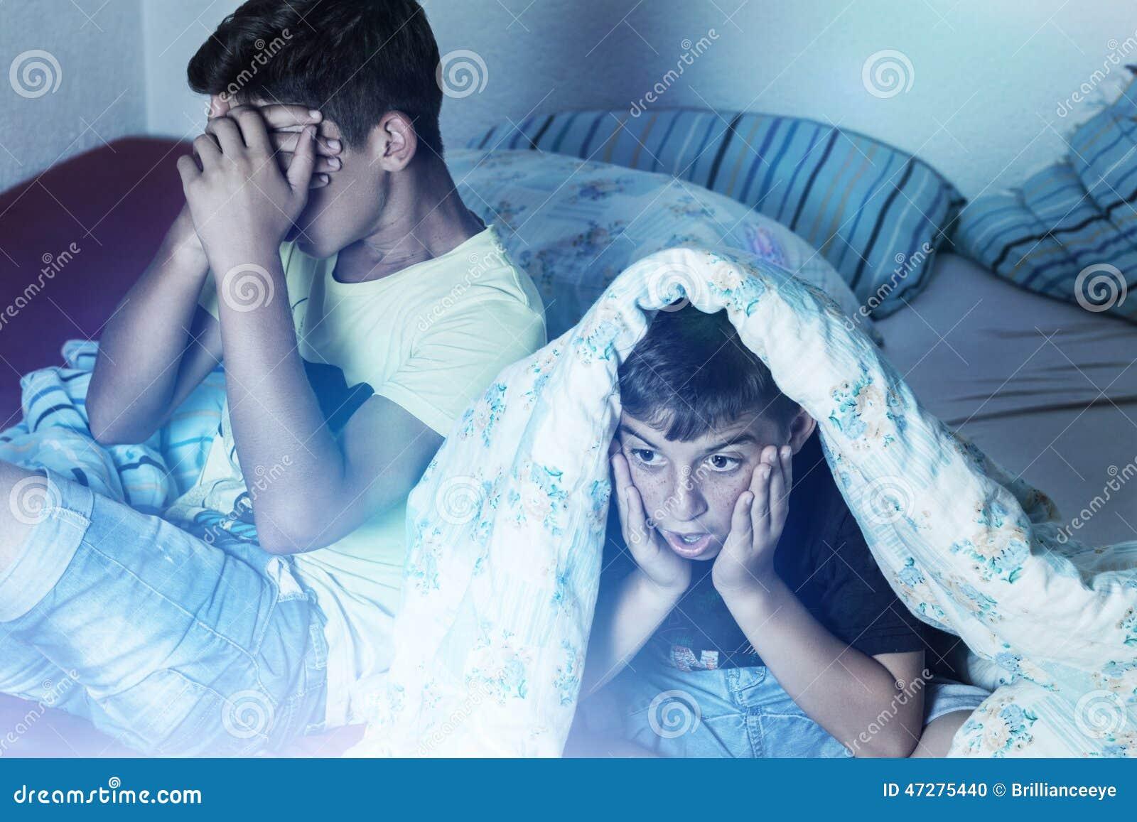 Horrified kids watching tv