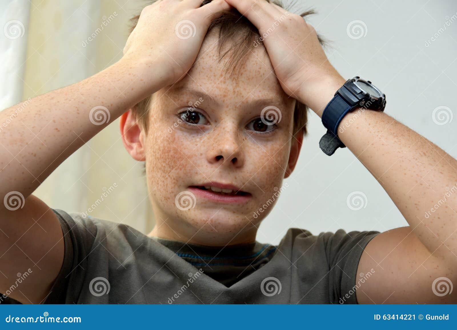 Horrified teenager boy