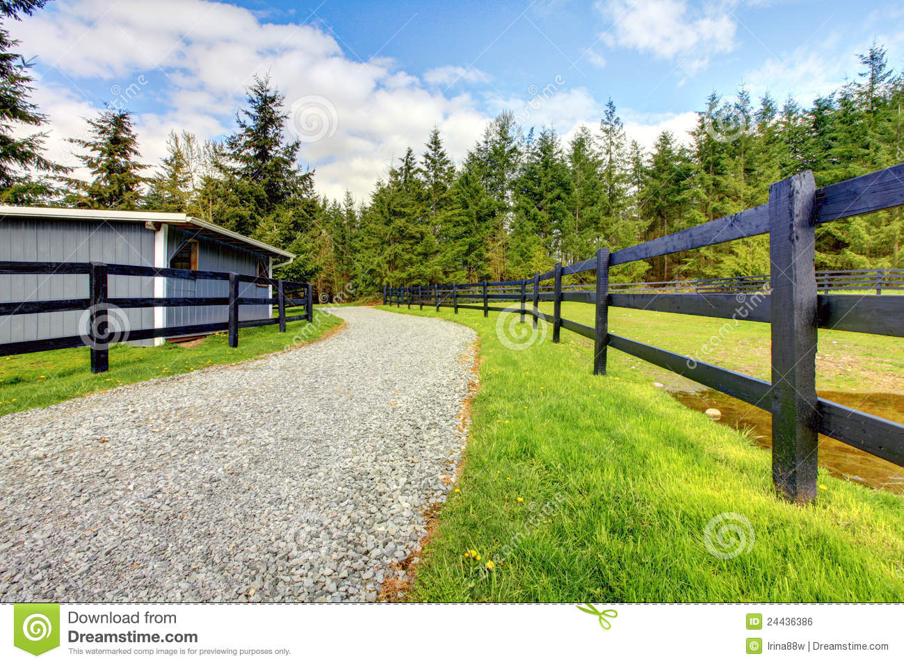 Horse farm with road fence and shed stock photo image