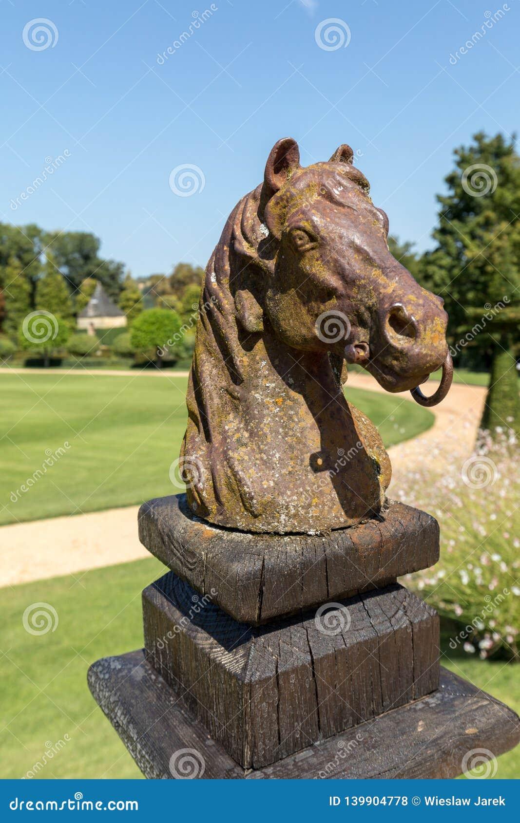 Horse head sculpture in the picturesque Jardins du Manoir d Eyrignac in Dordogne.