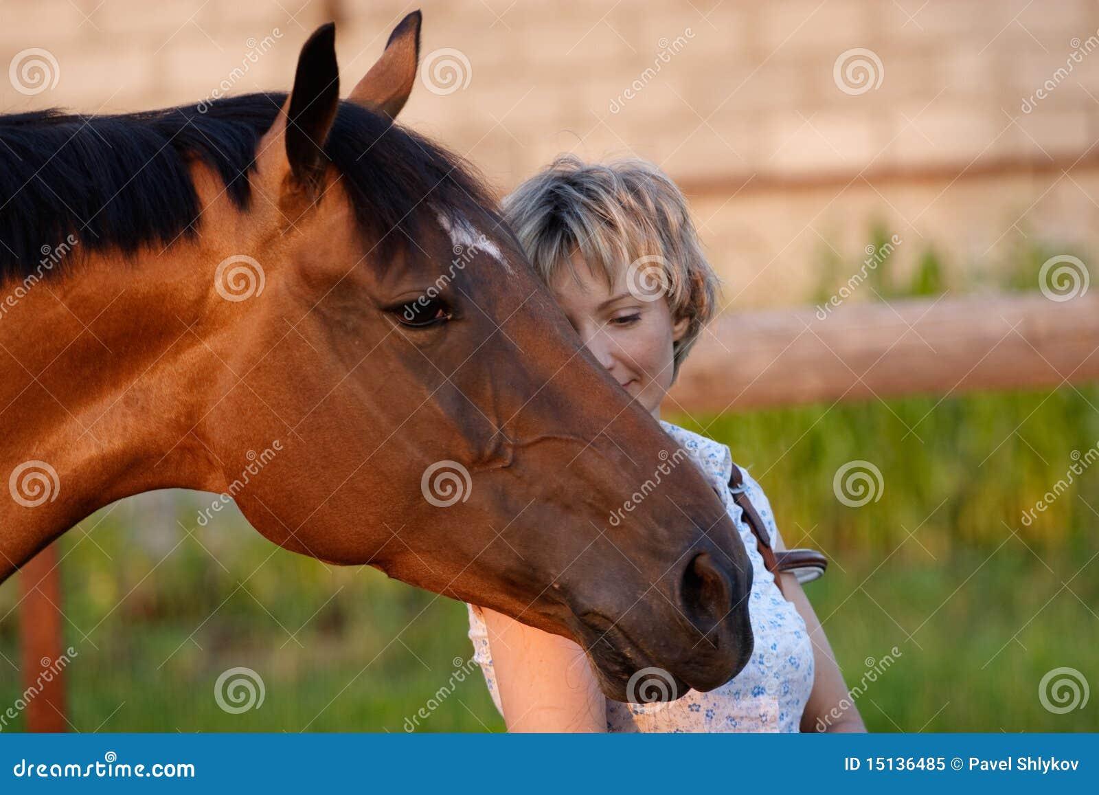 Horse head on womans shoulder