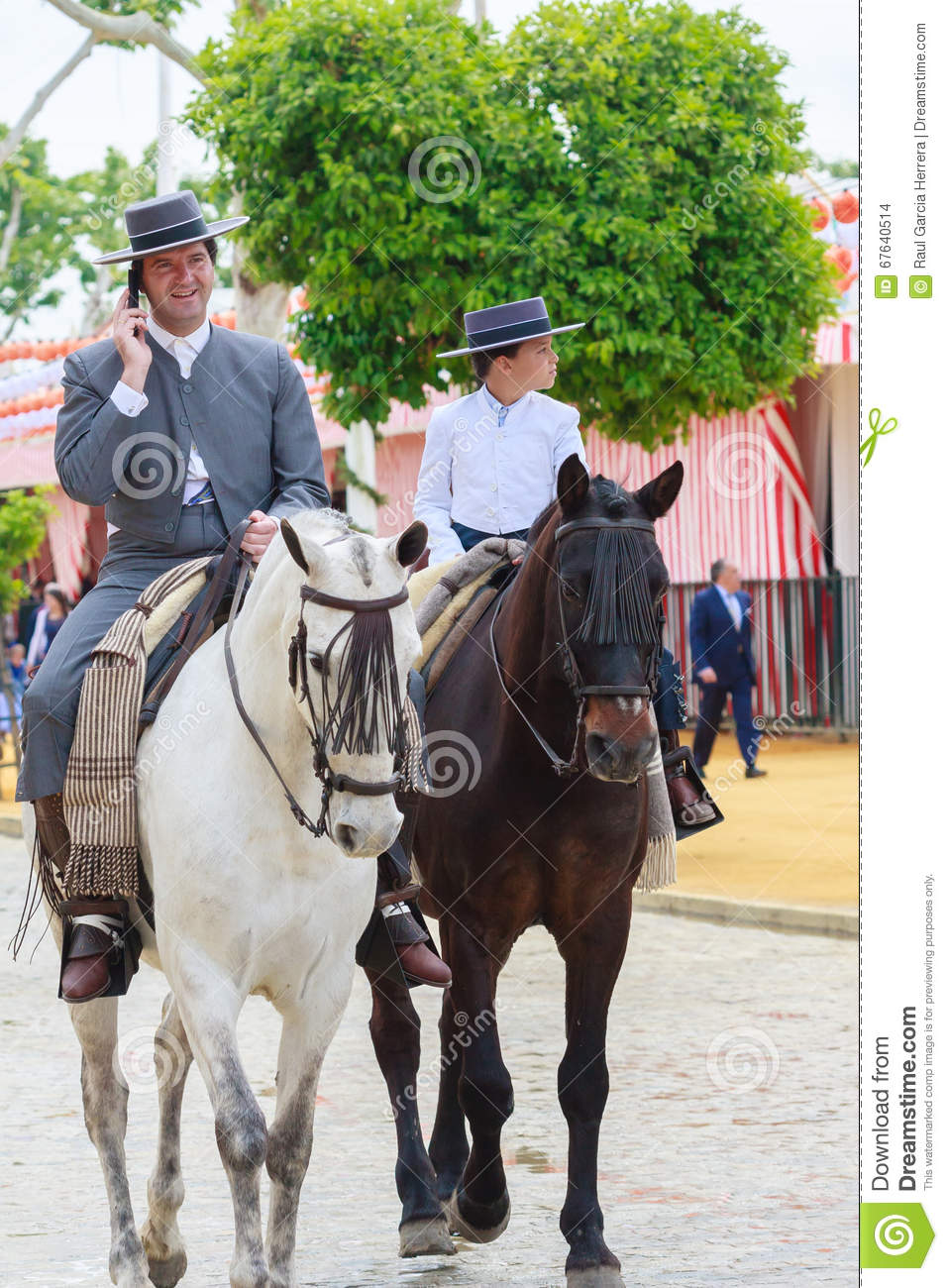 Horse riders taking a walk by the fair of Seville