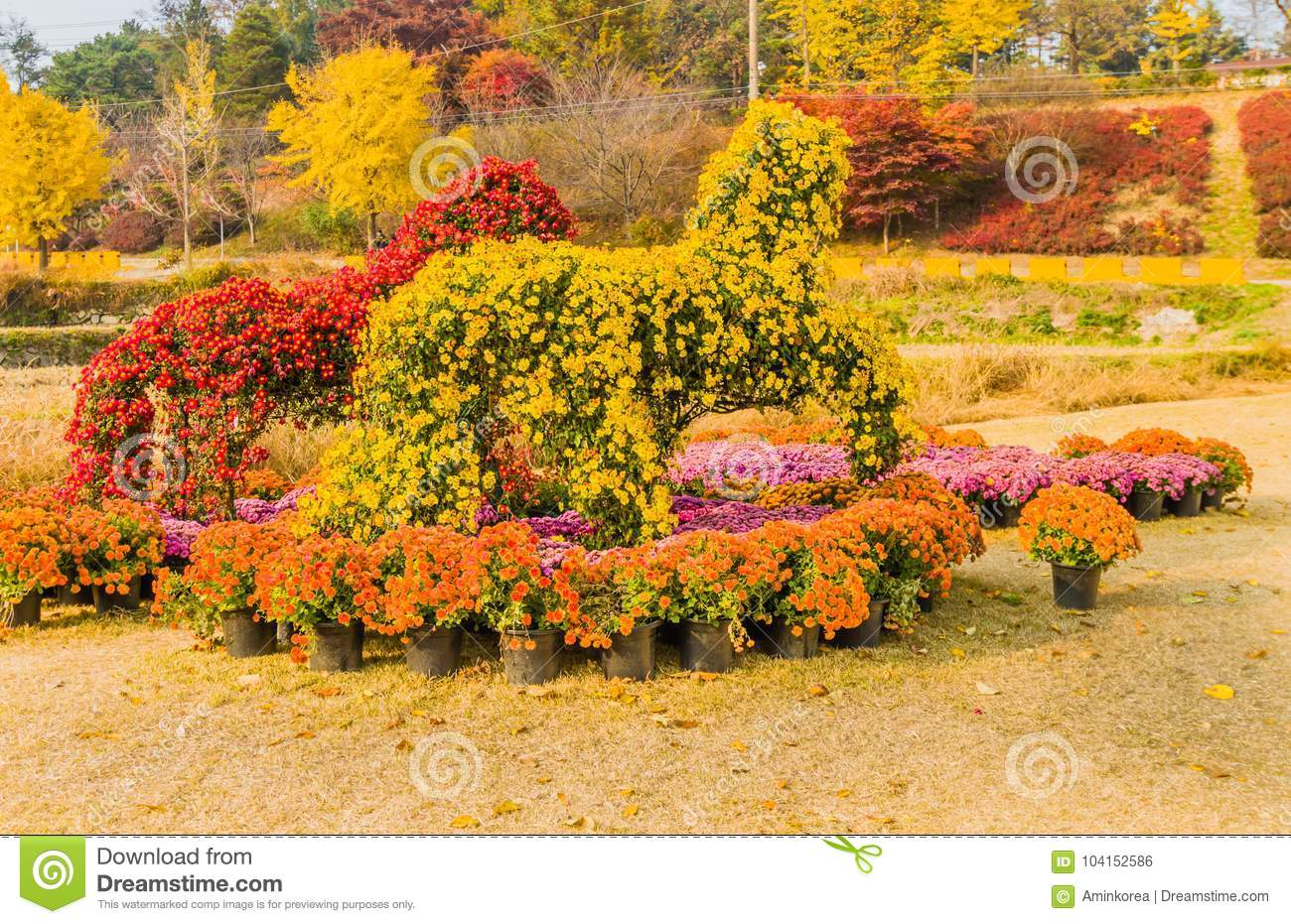 Horse Shaped Bushes Covered With Red And Yellow Flowers Stock Photo