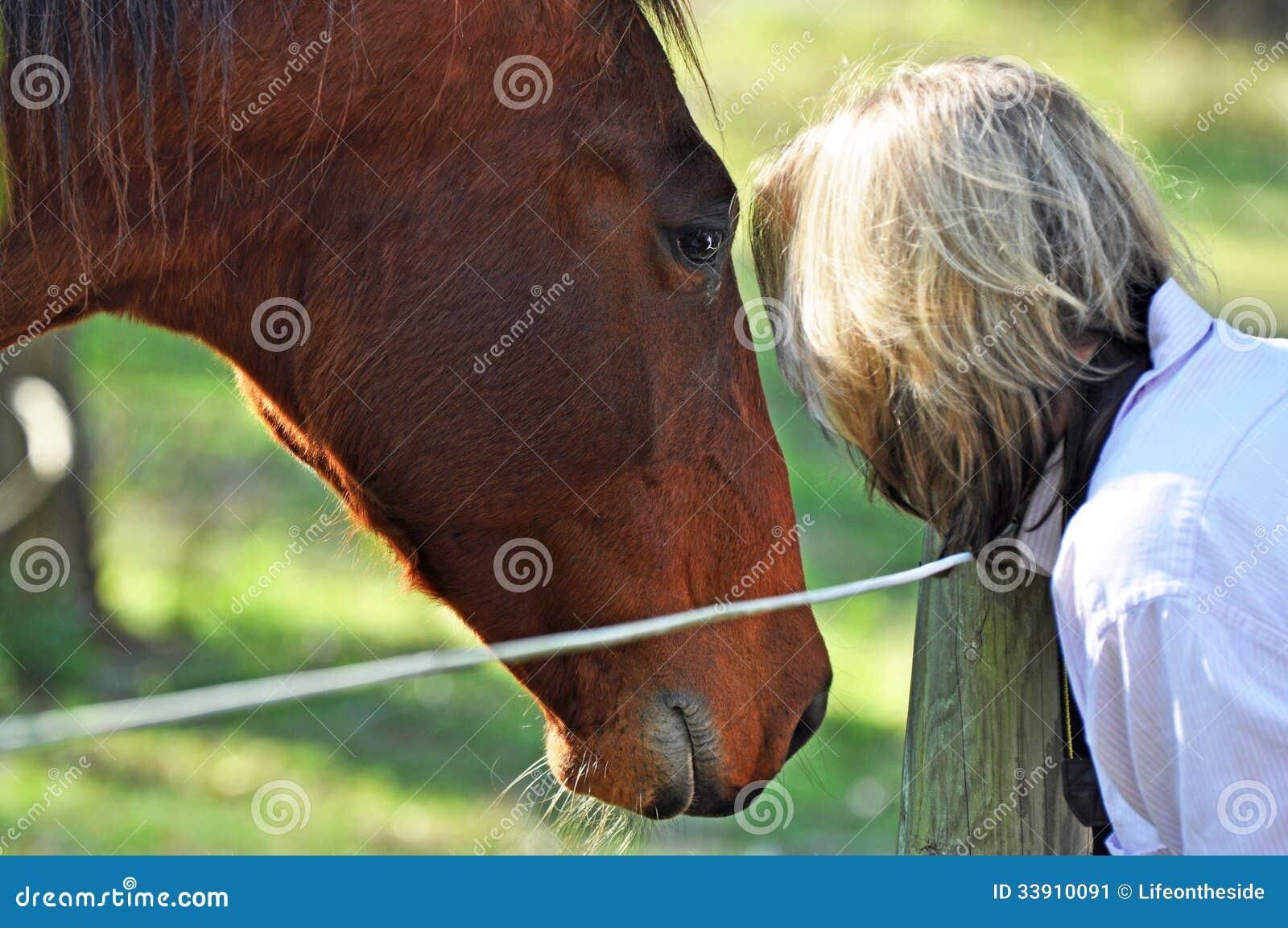 Horse whisperer - soft dreamy portrait woman & pet