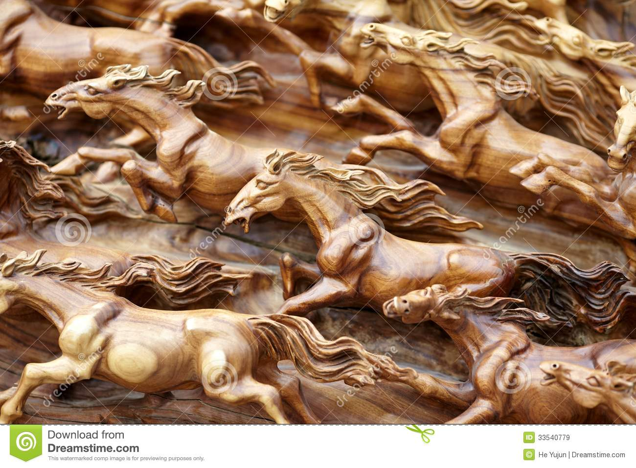 Horse wood carve on piece of big wood trunk.