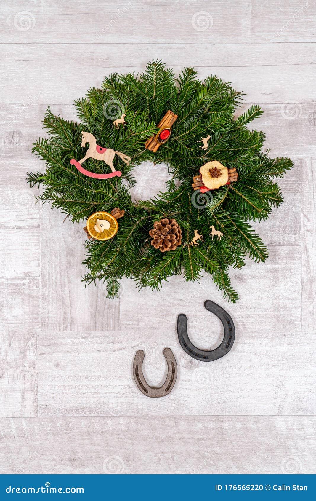 Horseshoe Christmas Decorations With Horse Ornaments On Wooden Background Stock Photo Image Of Hobbyhorse Decoration 176565220