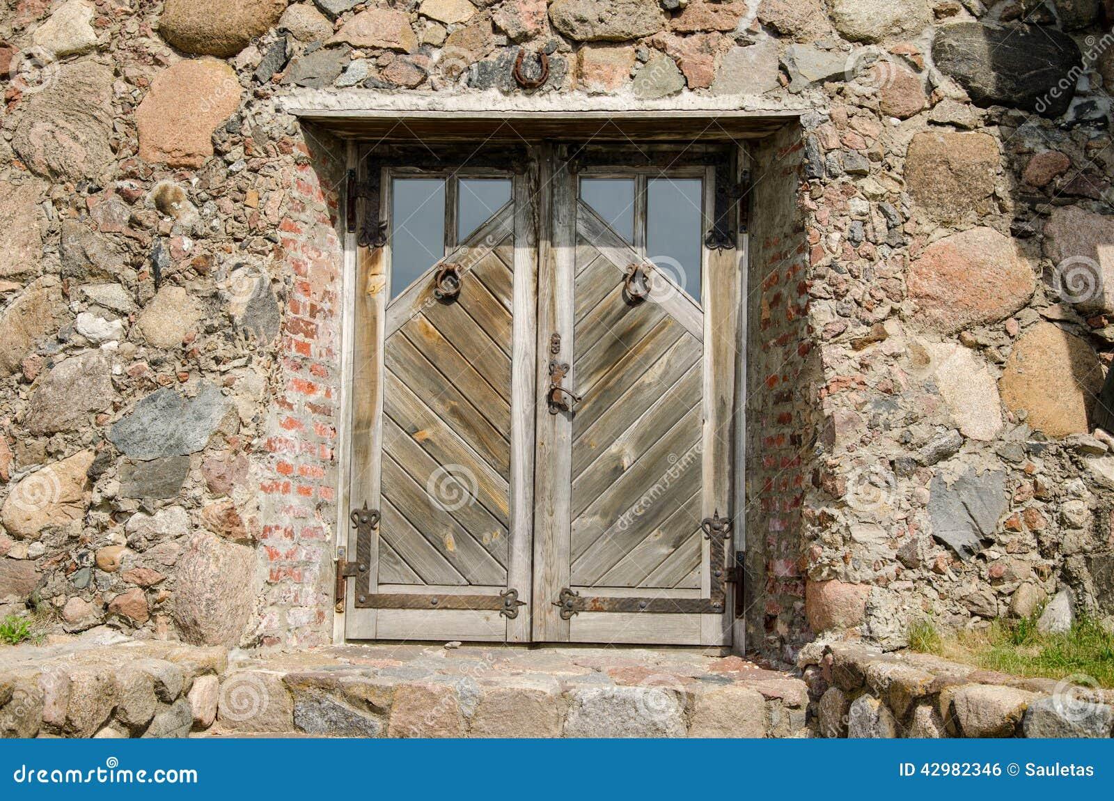 Horseshoe Hang Over Stone Wall Wooden Door