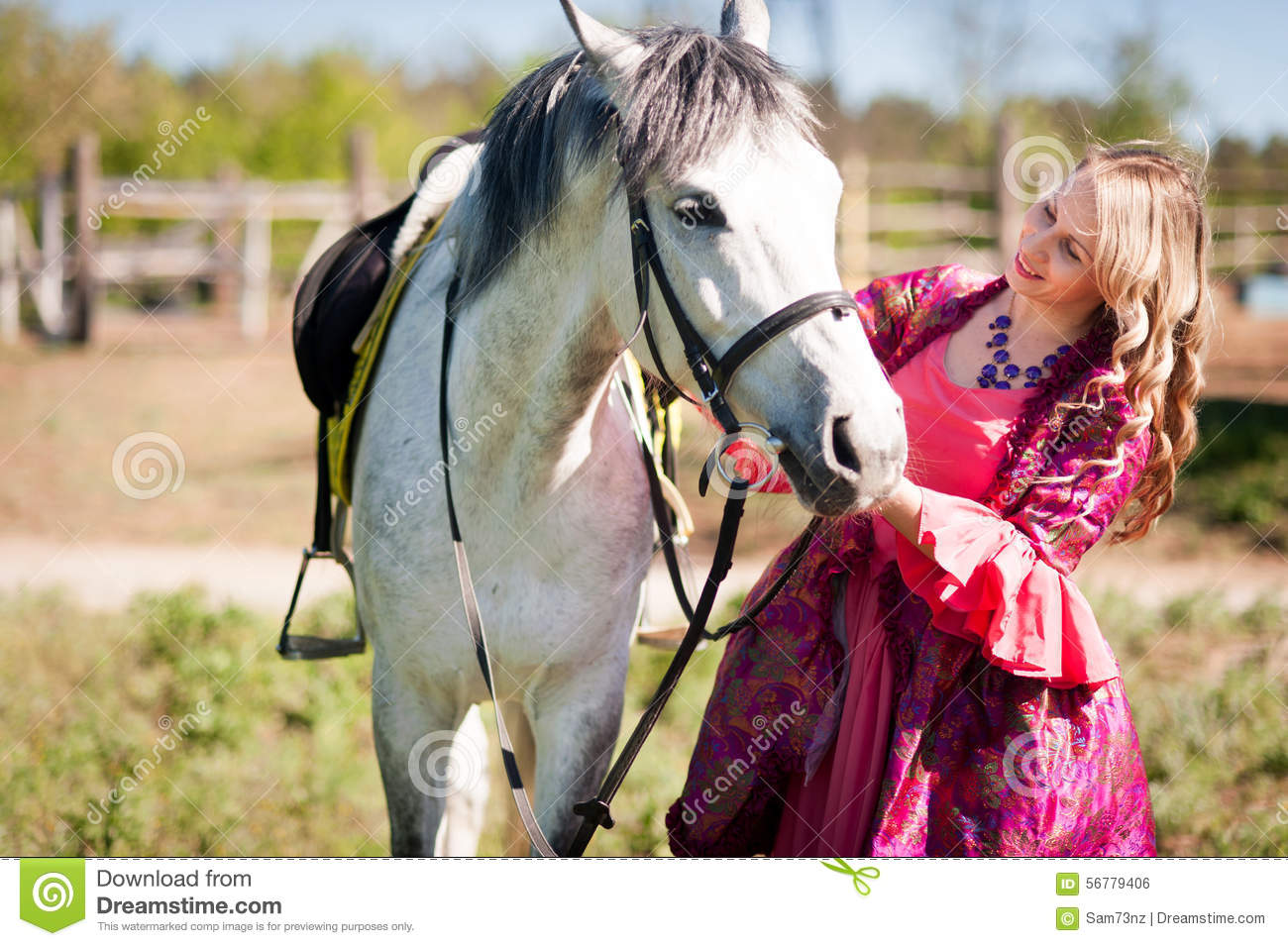 Horsewoman and white horse