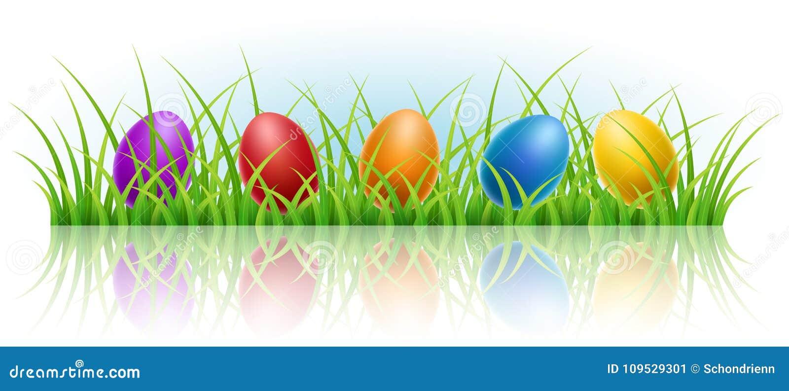 Horyzontalny sztandar z Wielkanocnymi jajkami w trawie
