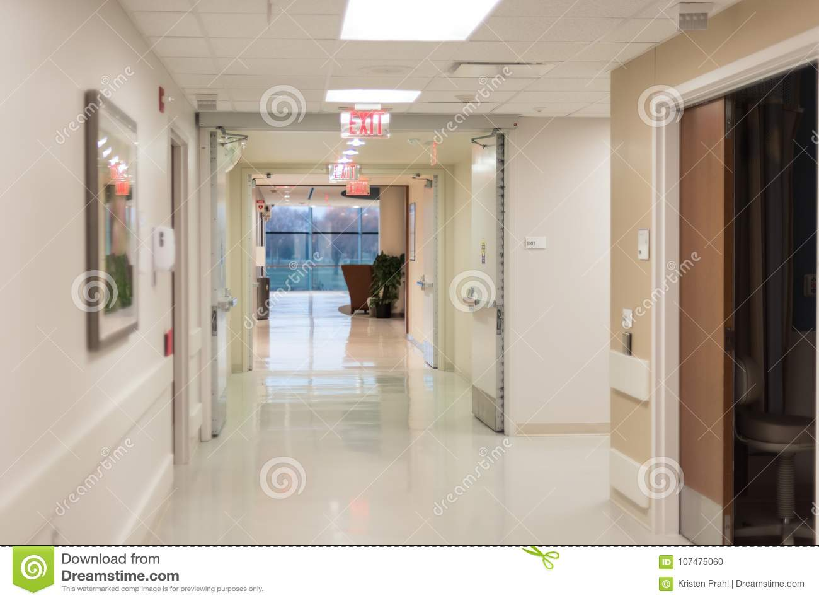 Hospital hallway with bright flourescent lights