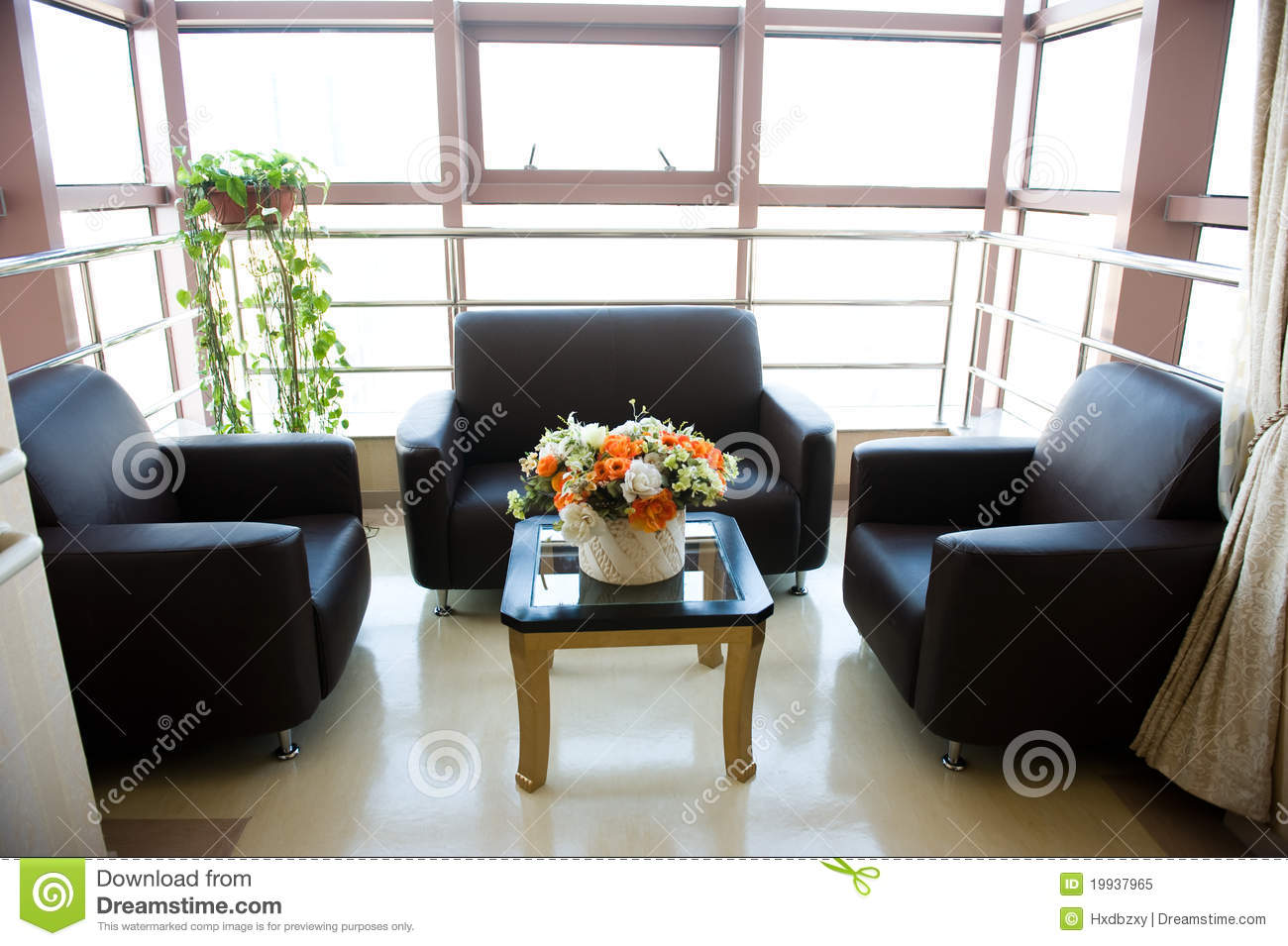 Hospital or clinic waiting room with empty chairs and table