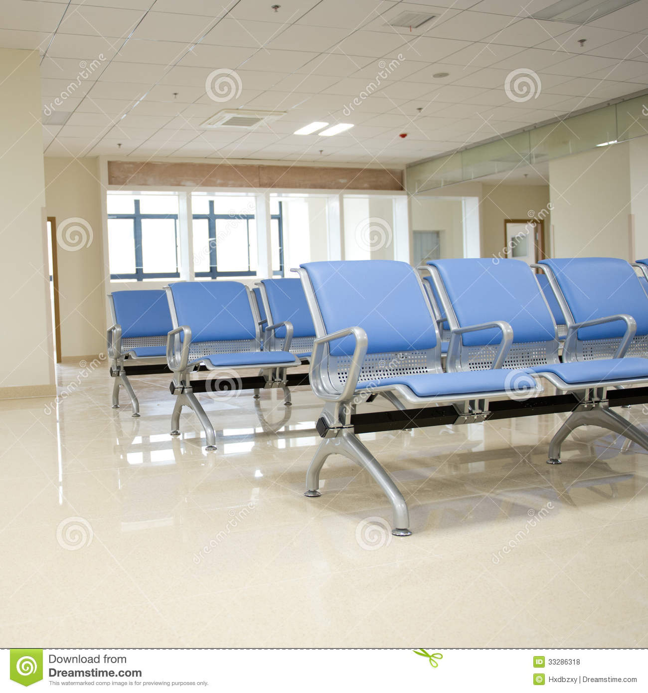 Hospital waiting room with empty chairs