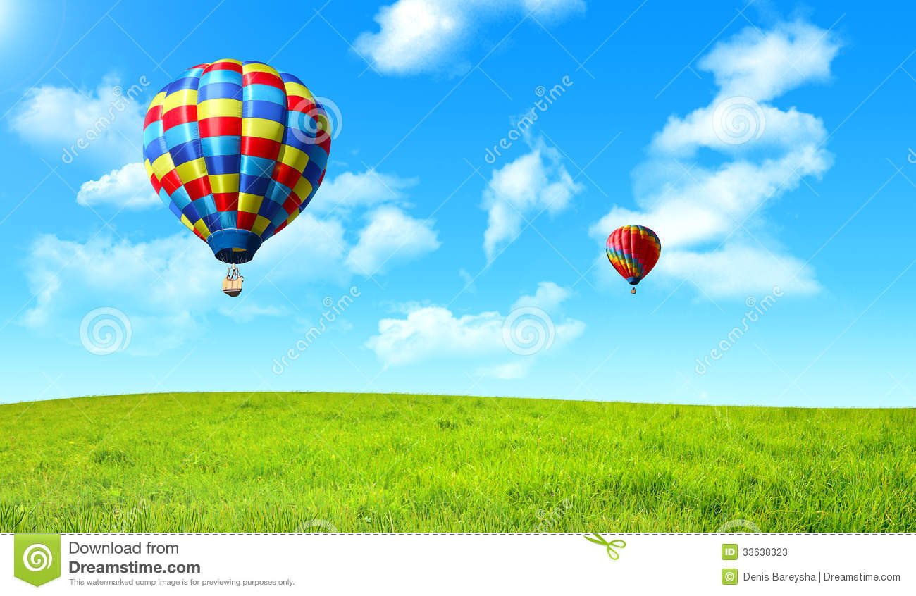 Hot Air Balloon Floating In The Sky Over The Green Field ...
