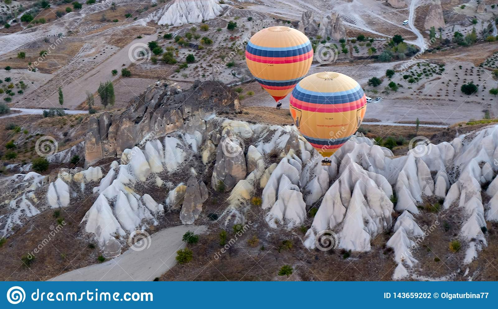 Hot air balloons hovering over the volcanic  valley . Living- Museum, Cappadocia,Turkey, autumn