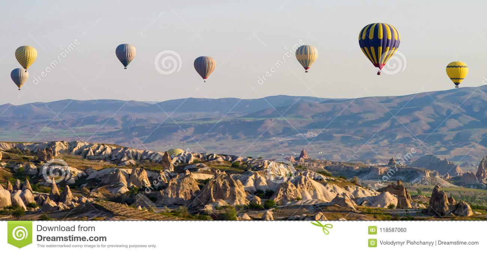 Hot air balloons at sunrise flying over Cappadocia, Turkey