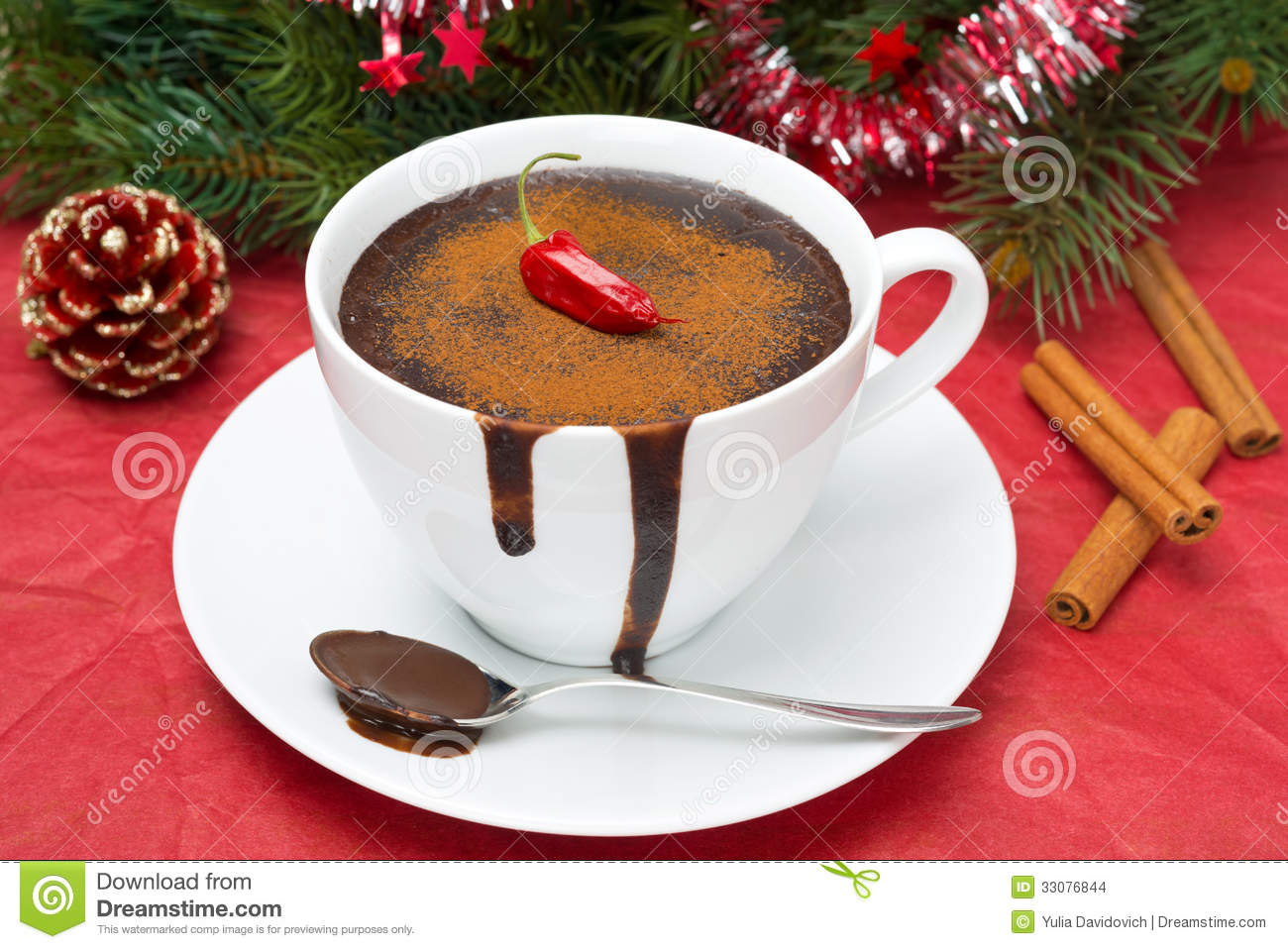 Hot chocolate with chili pepper and cinnamon on a background of the ...