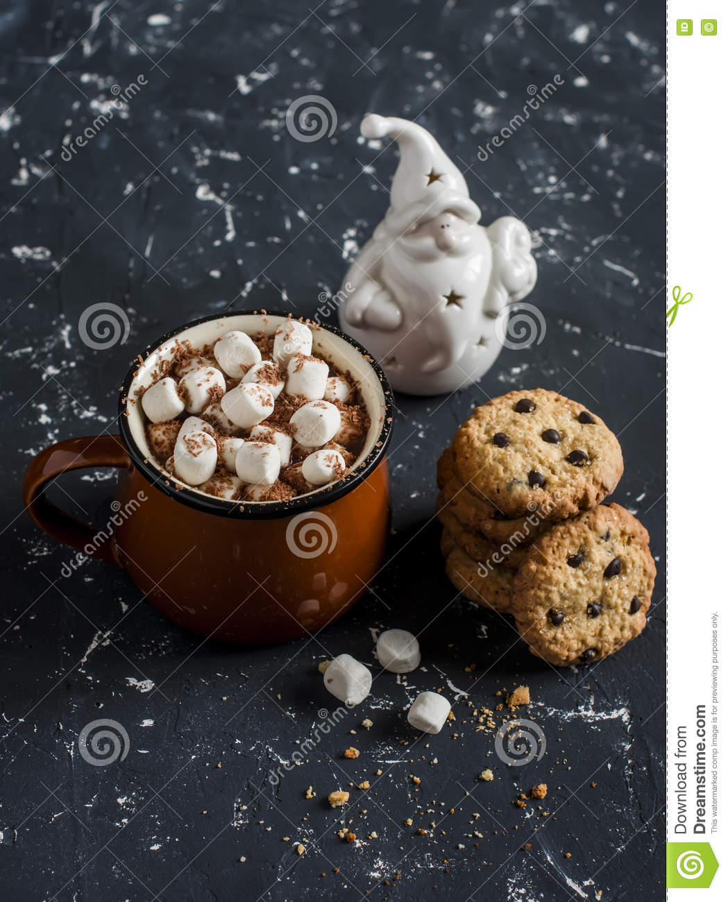 Hot chocolate, chocolate chip cookies and christmas ornament Santa Claus