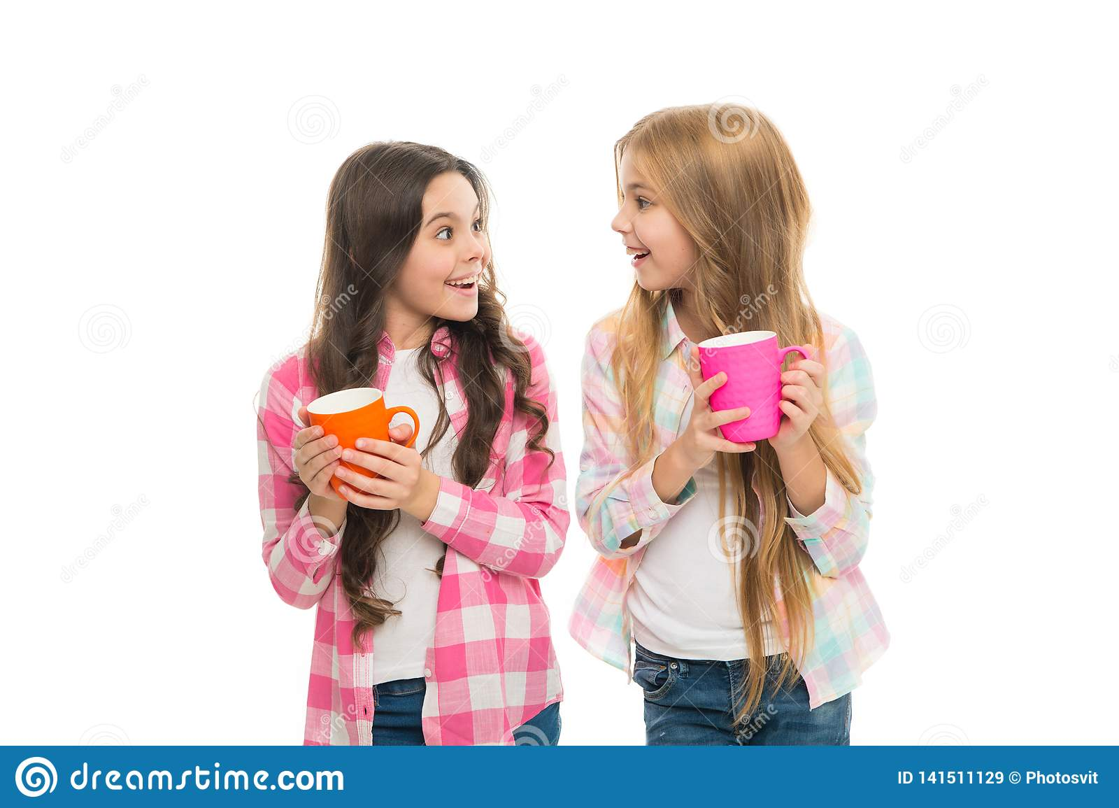 Hot cocoa recipe. Make sure kids drink enough water. Girls kids hold cups white background. Sisters hold mugs. Drinking