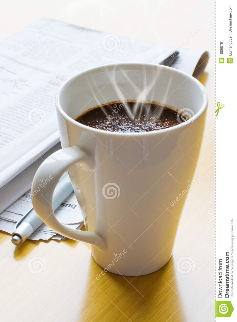 Hot coffee, ball-point and newspaper