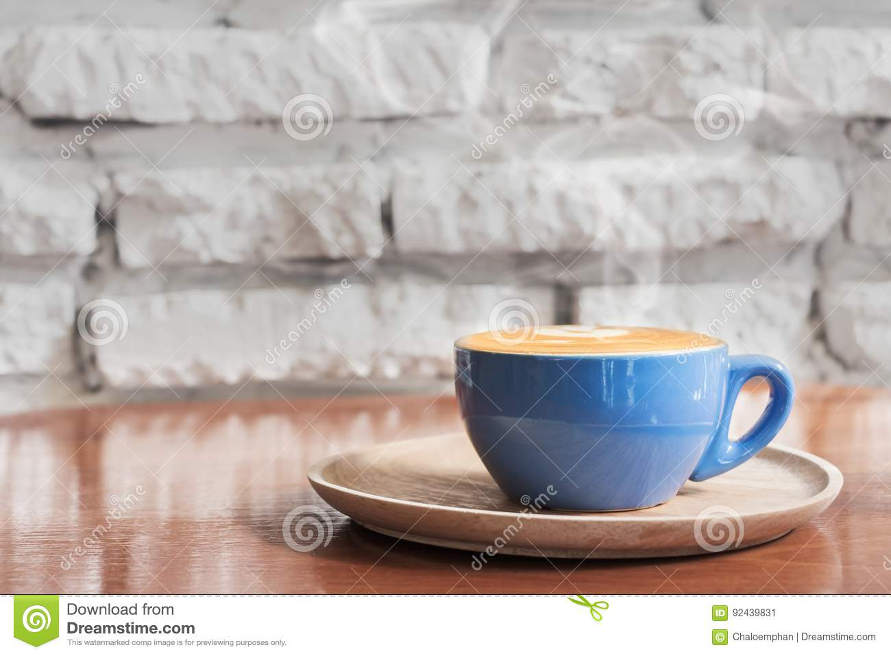 Hot Coffee cup with against white brick wall ba