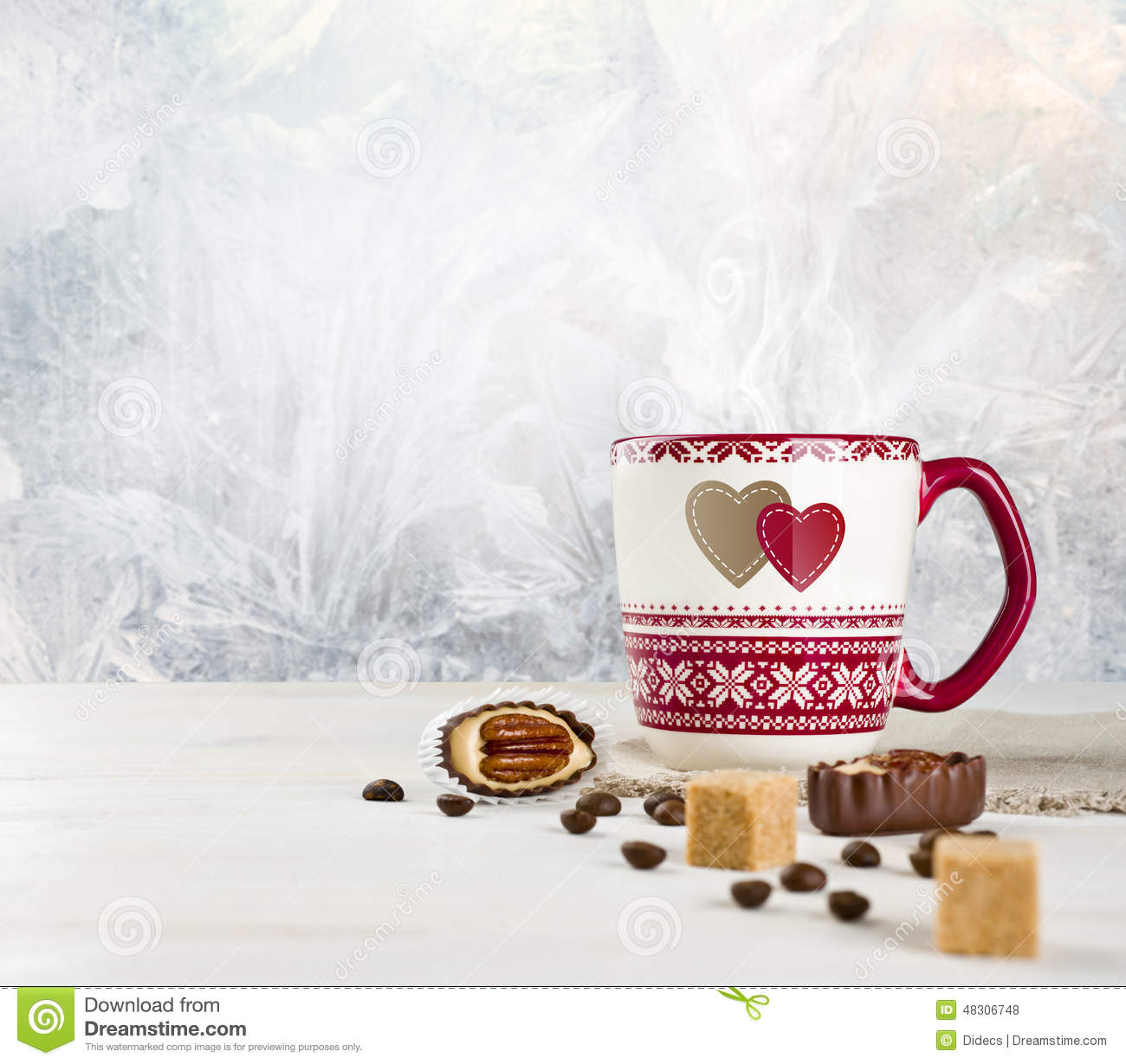 Hot Coffee Cup And Sweets Over Frosted Winter Background