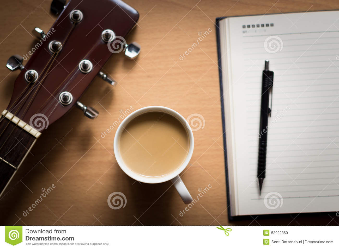 hot coffee with guitar and notepad on table break time for think