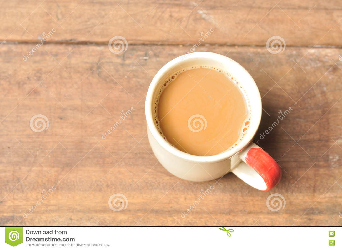 Hot coffee on old wooden plank