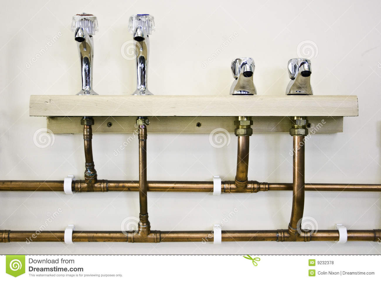 Hot And Cold Water Taps And Pipes Royalty Free Stock
