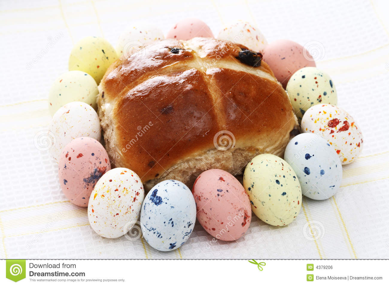 Hot Cross Bun Surrounded By Speckled Easter Eggs Royalty Free Stock Image