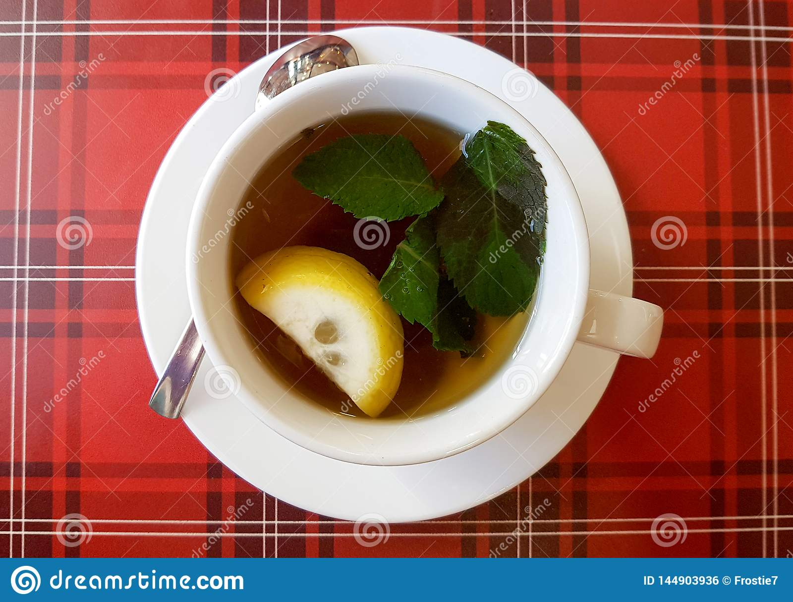 Hot cup of tea whith lemon and mint