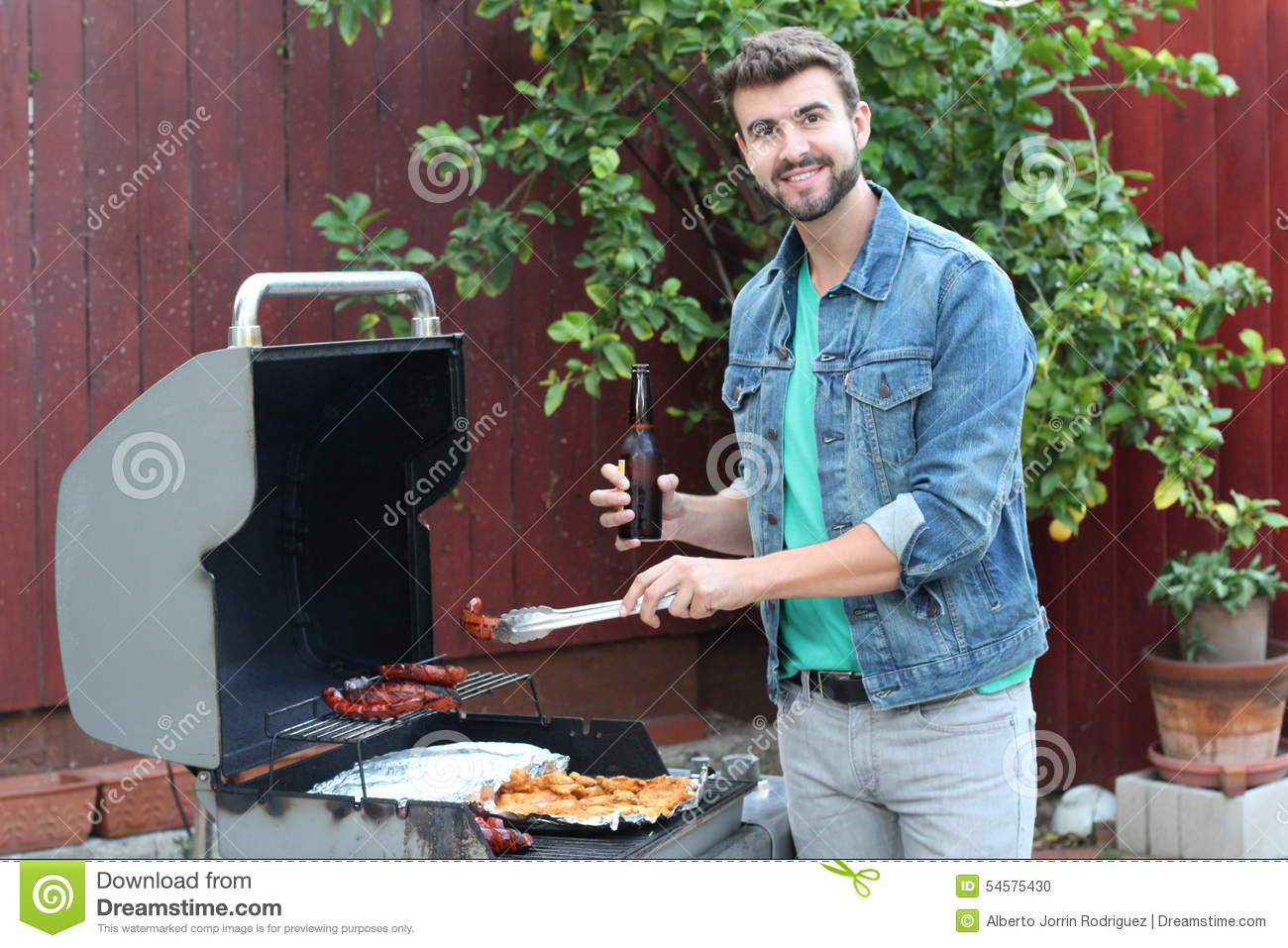 Hot Guy Preparing Dinner In Barbecue Stock Photo - Image of busy ...