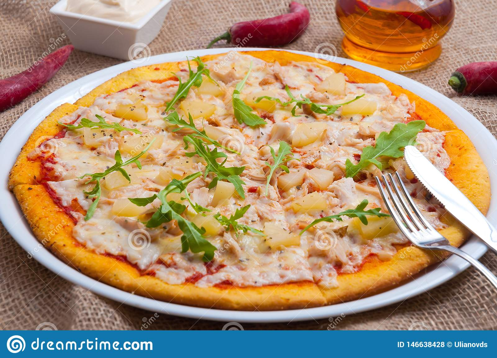 Hot Hawaiian pizza with pineapple and chicken