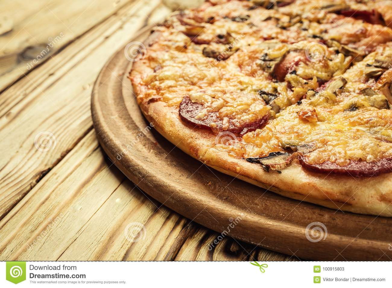 Hot pizza slice with melting cheese on a rustic wooden table.pepperoni pizza,Hot Homemade Pepperoni Pizza Ready to Eat,Supreme Pi