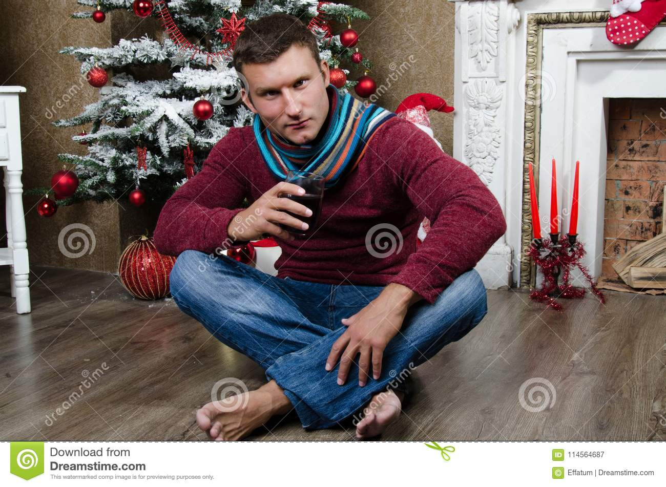Attractive Man Drinking Wine By The Fireplace. Christmas And ...