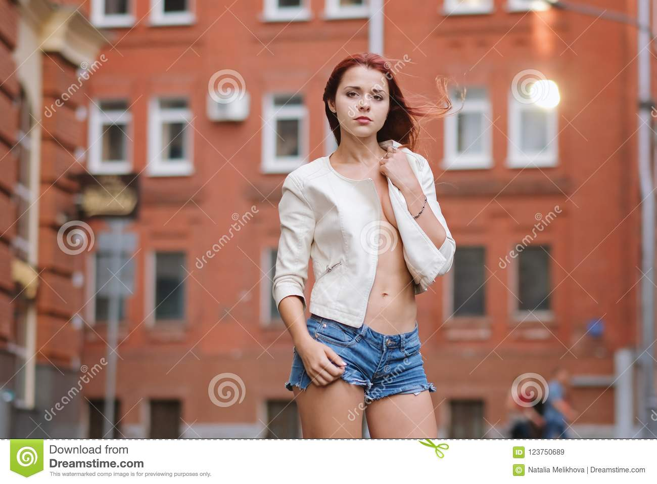 Hot redhair woman in the city. Nude girl. Fashion art photo.