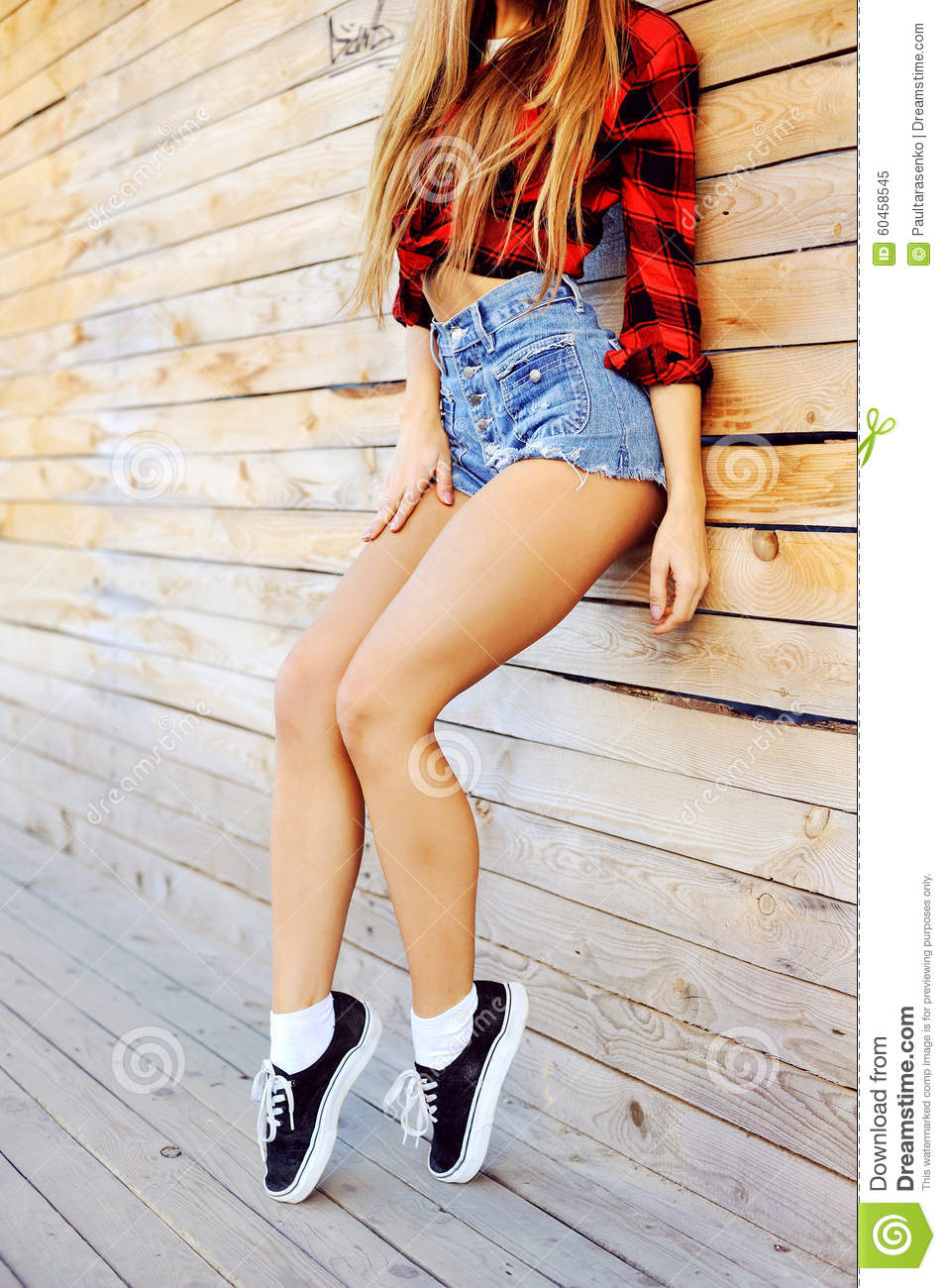 Hot Tan Slim Woman Legs In Sneakers And Jeans Shorts - Clos Stock ...