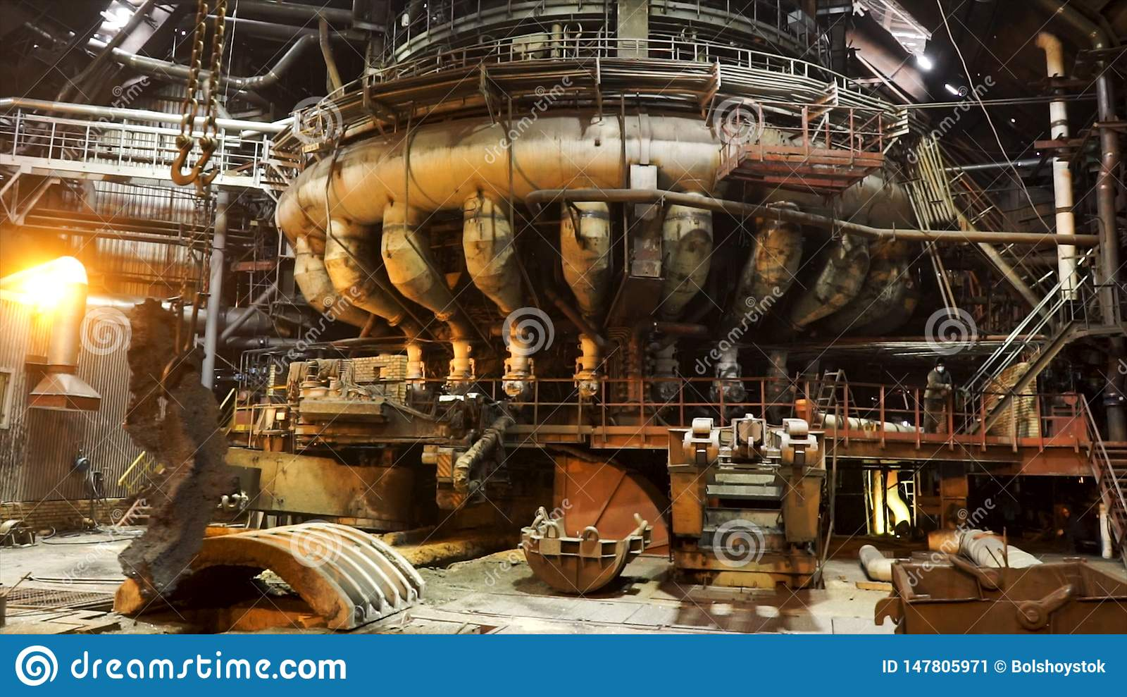 Hot shop of the metallurgical plant with modern machinery, industrial landscape. Stock footage. Molten metal production