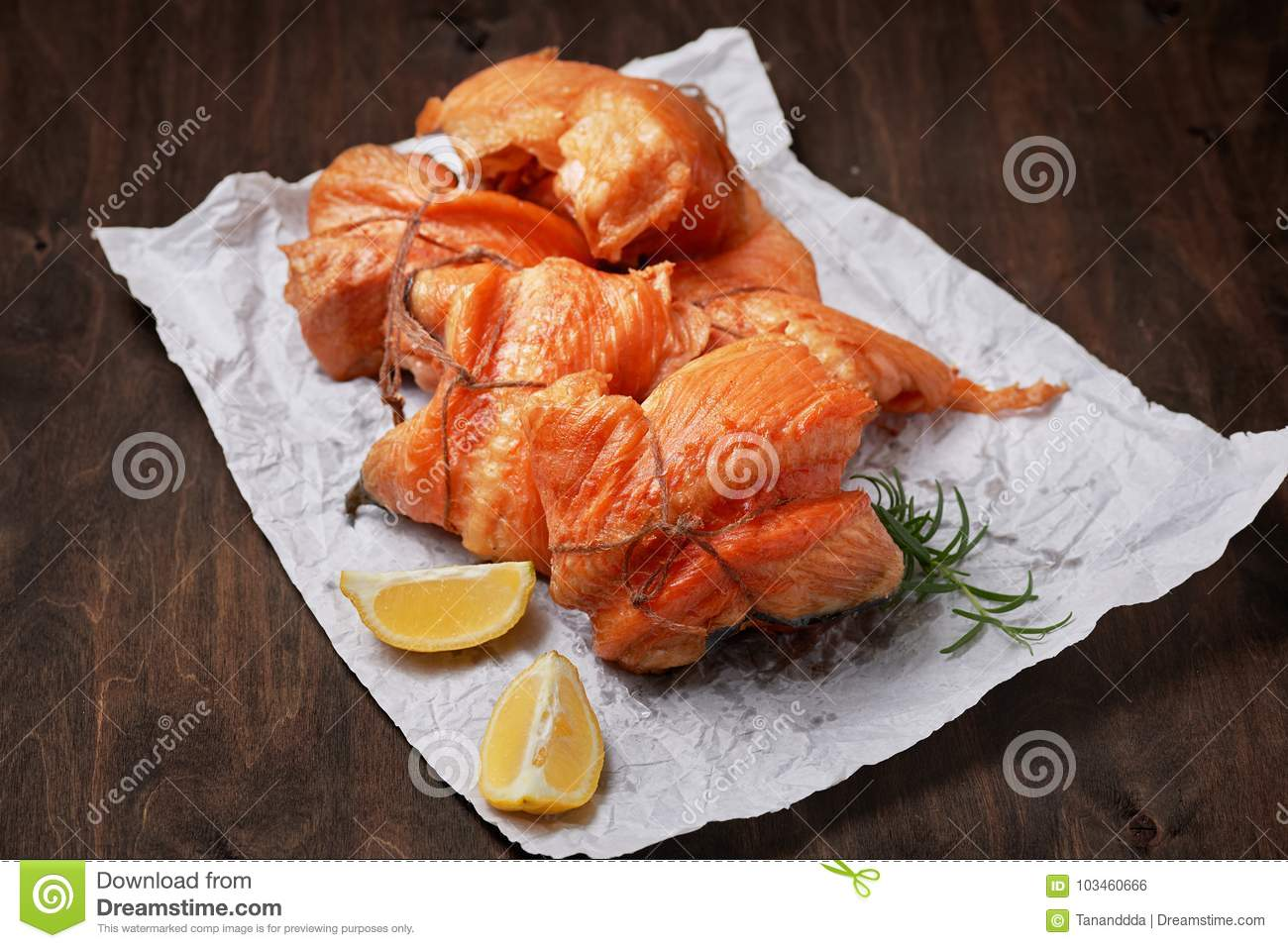 Hot smoked salmon fillet rolls on crumpled paper