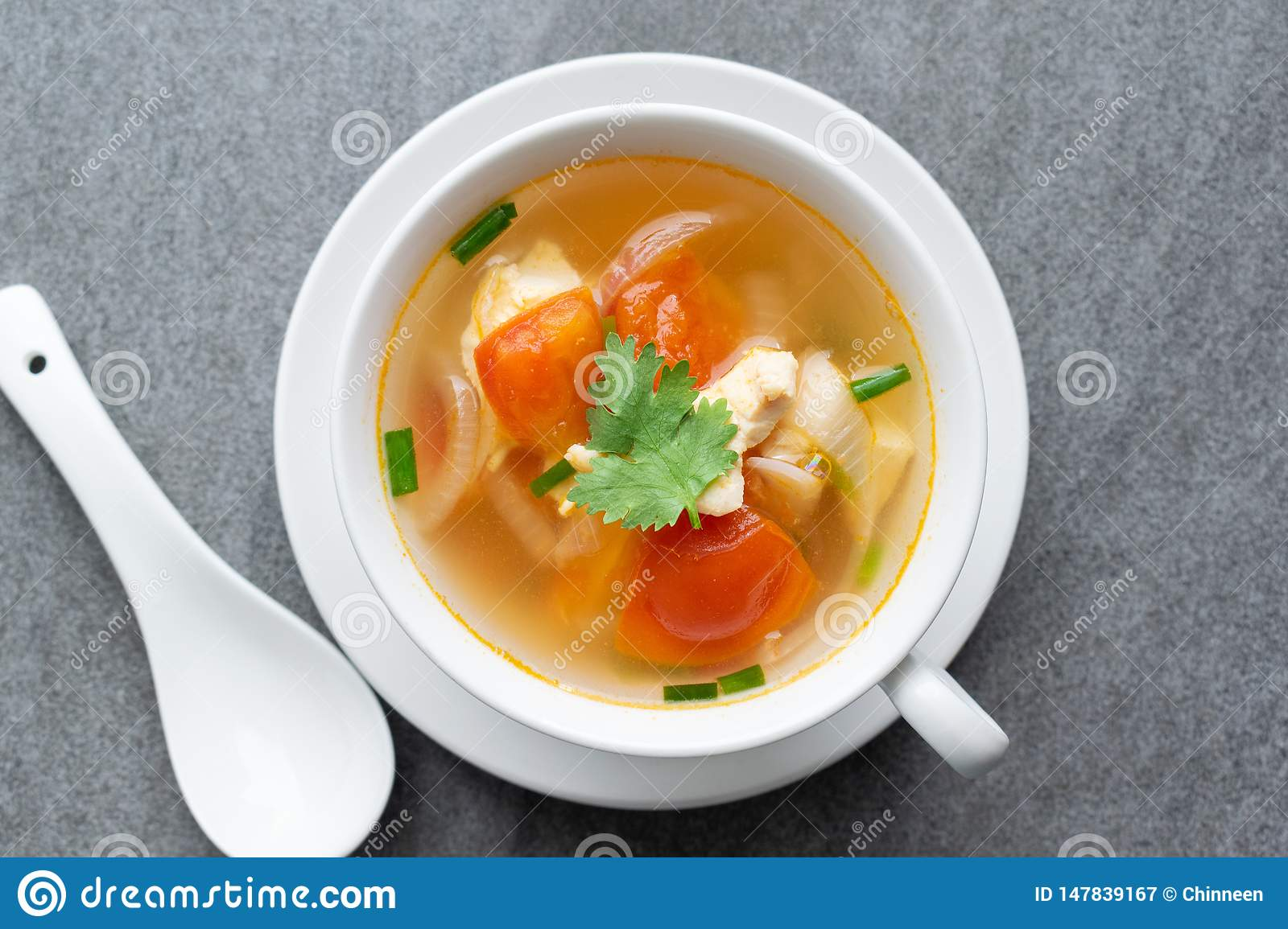 Hot soup chicken healthy at morning on concrete table
