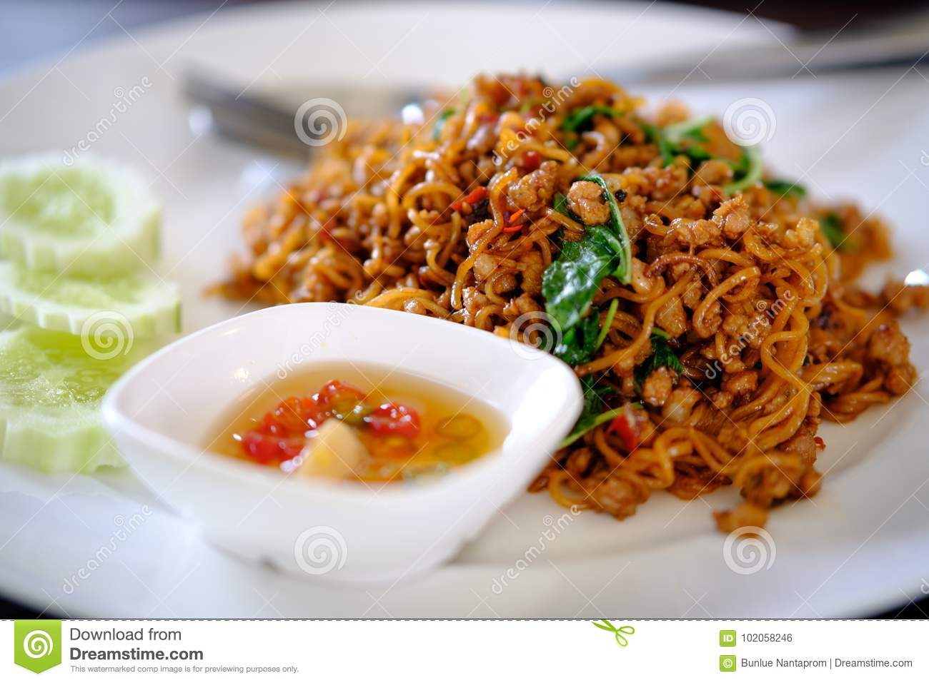 Hot And Spicy Red Noodle Ramen And Pork Fried Basil On White