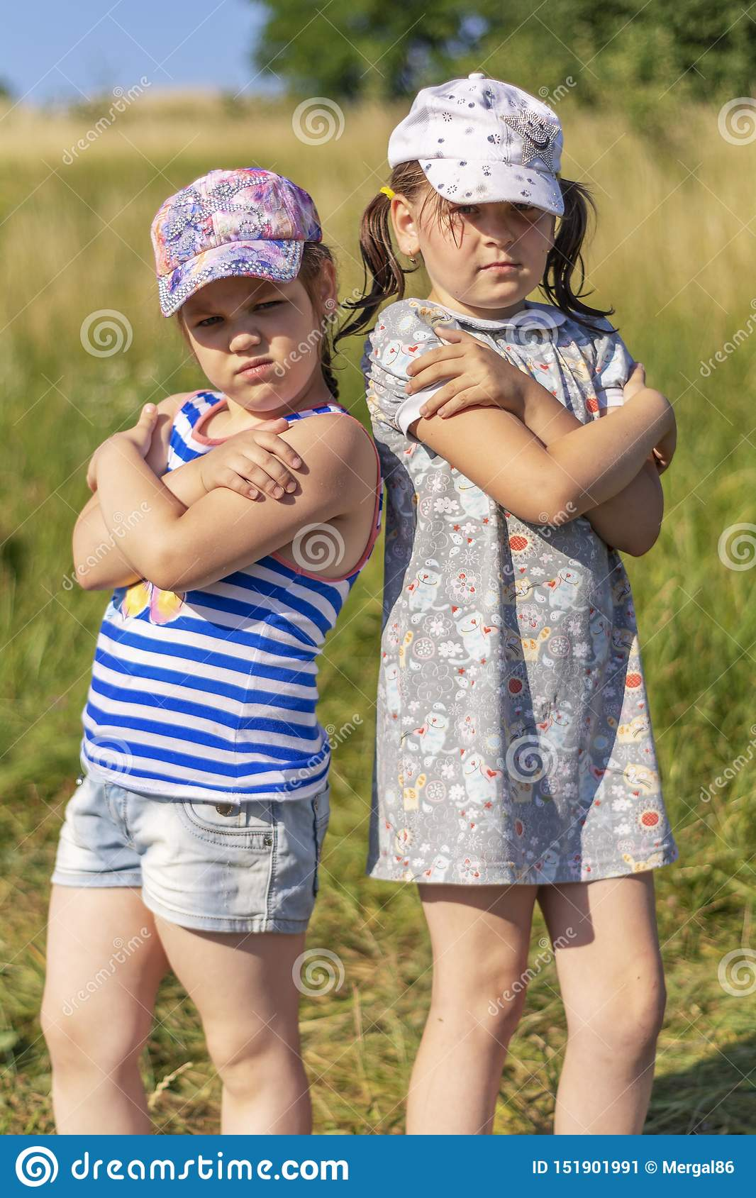 Hot Summer. Two little girl posing for the camera